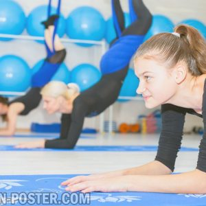 jual poster Young women doing aerial yoga